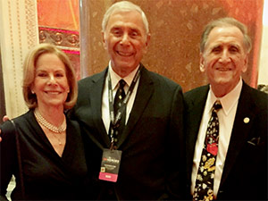 "Claire and IJSHOF chairman Alan Sherman, left and right, were present at honoree Harry Swimmer's Top Ten finalist honors at the 2016 ""CNN Hero of the Year"" telecast in New York."